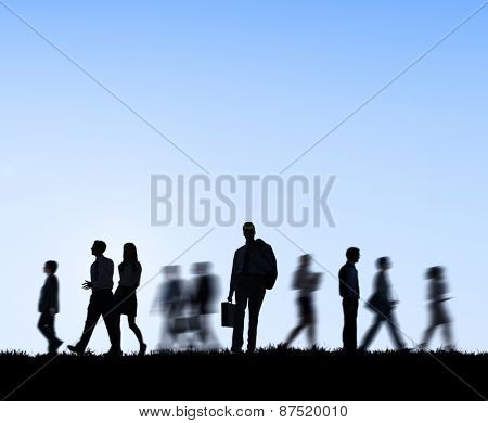Group of business people in motion.