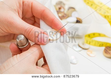 Sewing Button On Cloth