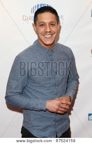 NEW YORK-MAR 28: Actor Theo Rossi attends the 2015 Garden Of Laughs Comedy Benefit at the Club Bar and Grill at Madison Square Garden on March 28, 2015 in New York City.
