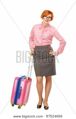 Full Length Portrait Of A Business Woman In Glasses  In Business Trip Standing With A Pink Travel Su