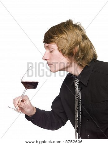 Men smelling wine