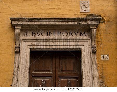 Historic Roman doorway set in a Ochre coloured stone wall