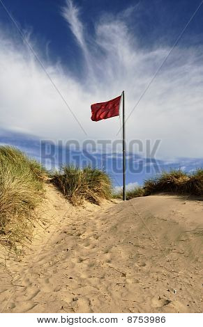 Red Flag On Sand Dune