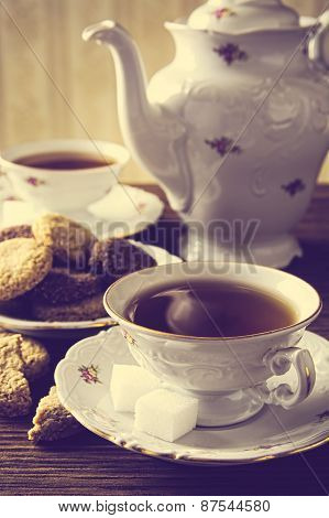 Old-fashioned Image With Two Cups Of Tea Vintage Effect With Cookies