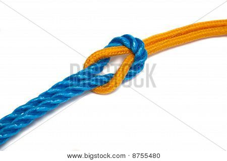 Yellow And Blue Ropes Tied Together With A Reef Knot