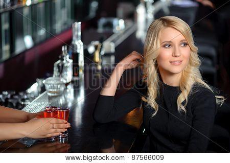 Beautiful woman in the bar