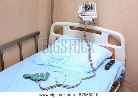 Head of the bed with a pillow and electroencephalograph in a hospital ward
