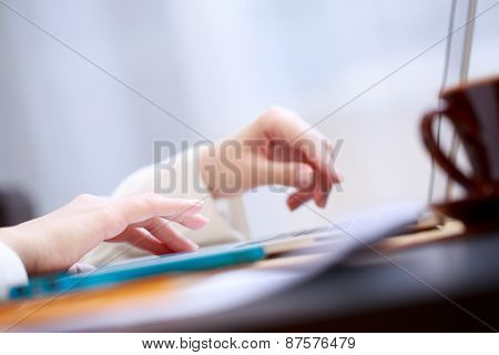 Close-up shot touching laptop trackpad.