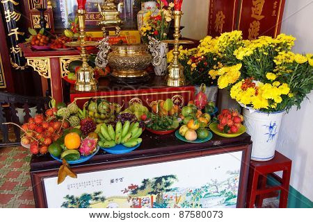 HOI AN VIETNAM - FEB 3 - 2015 - Offerings of fruit at the altar of a fertility deity Fukian Assembly Hall Hoi An Vietnam poster