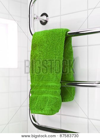Green Towel on a dryer in modern bathroom environment