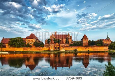 HDR image of medieval castle in Malbork with reflection in river poster