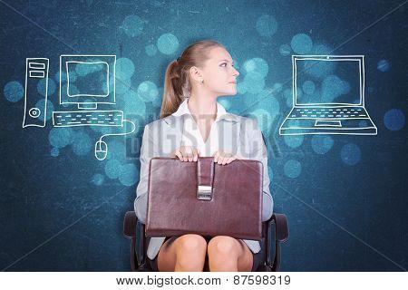 Businesswoman Deciding Between Desktop and Laptop