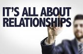 Business man pointing the text: It's All About Relationships poster