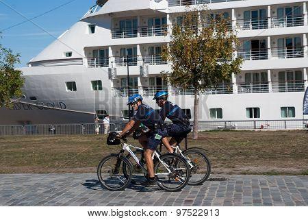 Police Officer Patrol On A Bike