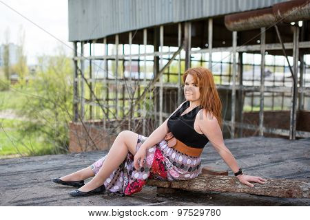 Cute young red-haired girl on a walk