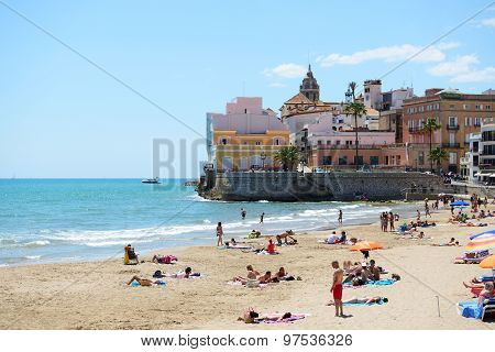 Sitges, Spain - May 23: The Tourists Enjoiying Their Vacation On The Beach On May 23, 2015 In Sitges
