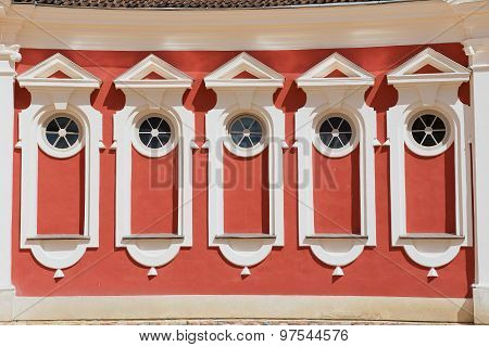 Exterior of the red painted stables building windows next to Rundale palace in Pilsrundale, Latvia.