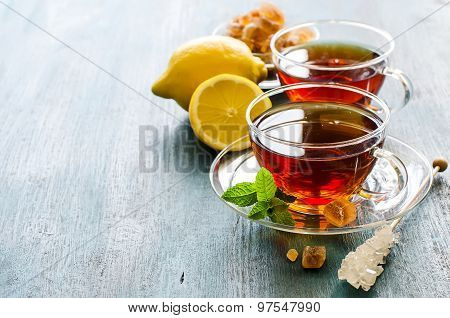 Cup Of Tea With Mint Leaf And Chrystal Sugar On Dark Rustic Copy Space Background
