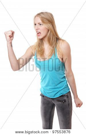 furious angry aggressive young woman screaming and threatening with clenched fist poster