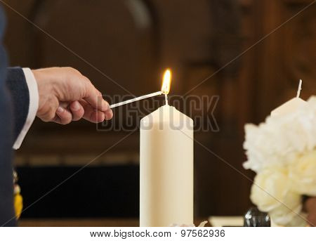 Man lighting wedding candle