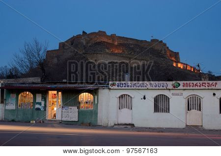 Night View Of Gori Fortress Located On Hill From Street Market,georgi