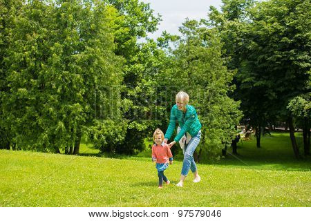 Portrait of happy mother and baby playing