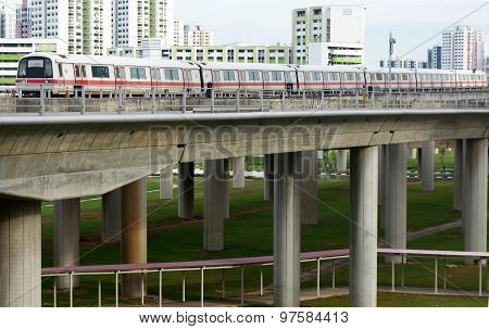 Singapore Mass Rapid Train (mrt) Travels On The Track In Jurong East, Singapore