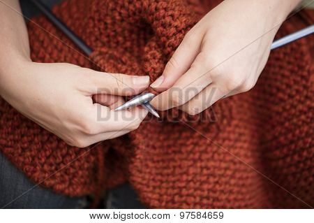 Close Up Of Knitting Hands