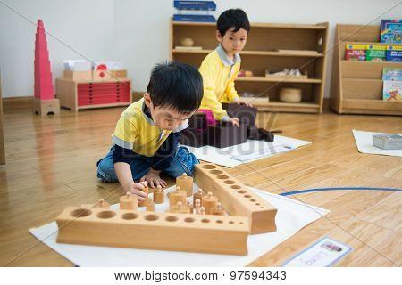 Children study and play in a kidergarten school in Hanoi, Vietnam