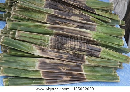 Kanom Jark Thai sweetmeat made of flour coconut and sugar with nipa plam leaves