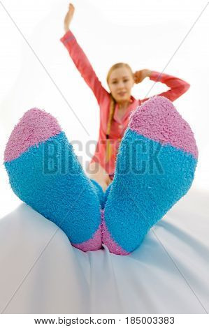 Woman In Pajamas Wearing Furry Warm Socks