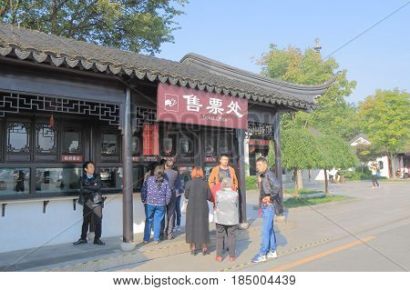 SUZHOU CHINA - NOVEMBER 3, 2016: Unidentified people buy admission for Fenqiao Scenic Area. Famous Hanshan temple is located in Fenqiao Scenic Area.