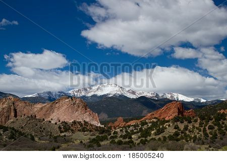 Pikes Peak and Garden of the Gods on a Spring or summer Day with clouds rolling over the mountain top