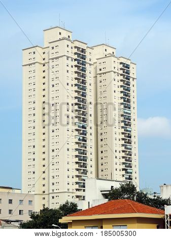 Two tall residential buildings in the cityscape
