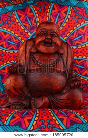Buddha Statue On A Colorful Background / Featuring A Wooden Statue Of  Cheerful Wise Buddha On Color