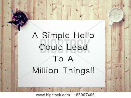 Inspiring motivation quote handwritten on a notepad a simple hello could lead to a million things. White pad paper image.