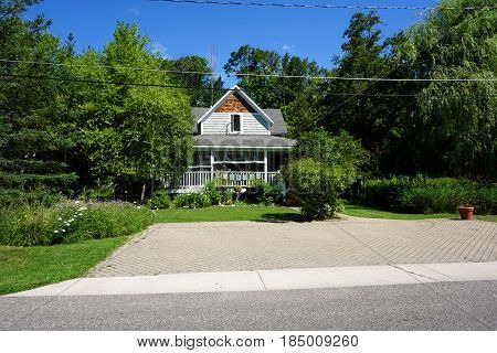 HARBOR SPRINGS, MICHIGAN, UNITED STATES - AUGUST 5, 2016: A single family Victorian home with a wraparound porch, on Fourth Street in Harbor Springs.