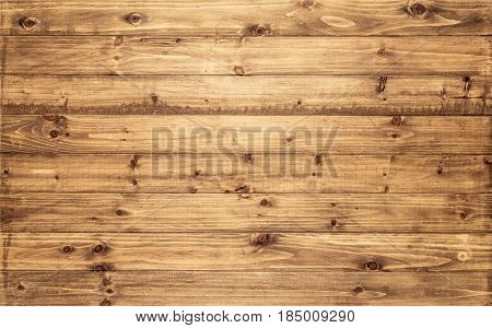 Light brown wood texture background viewed from above. The wooden planks are stacked horizontally and have a worn look. This surface would be great as design element for a wall floor table etc...