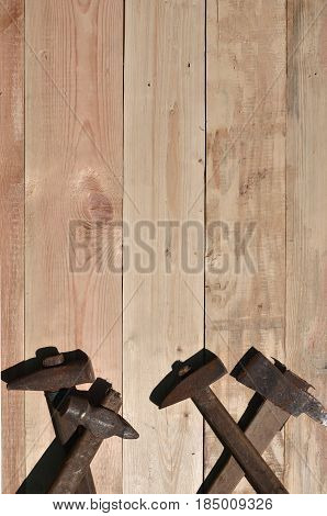A Few Rusty Hammers Lies On A Wooden Table In A Workshop