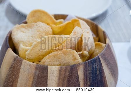 Prawn crackers chip in a wood basket