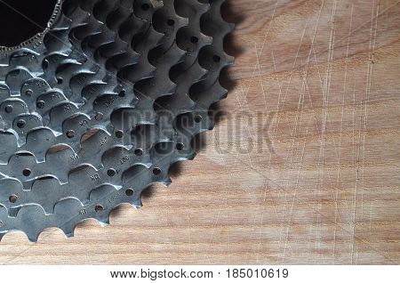 Rear Cassette (sprocket) From A Mountain Bike Lying On A Wooden Table In A Bike Shop