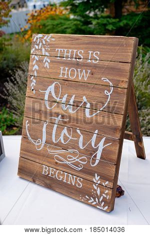 Wedding decoration sign says this is how our story begins.