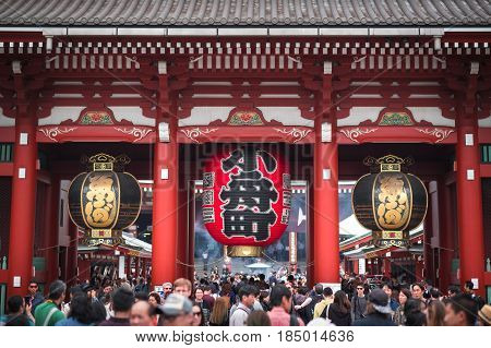 TOKYO JAPAN - APRIL 17: Unidentified people at the Senso-ji Temple on Apr 17 2017 in Tokyo Japan.The Senso-ji Temple is the symbol of Asakusa and one of the most famous temples in Japan.