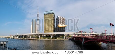 TOKYO - JAPAN : 16 APRIL 2017 - Sumida river panorama view in daytime witth many tourists on the bridge on 17 April 2017.