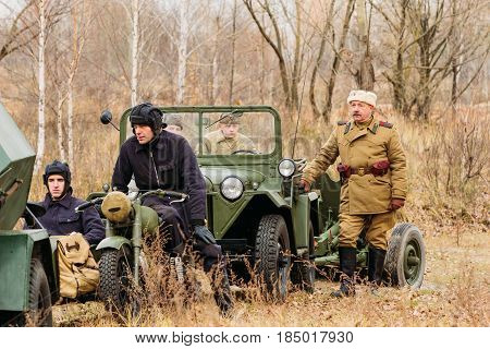 Gomel, Belarus - November 26, 2016: The sergeant-major of the Red Army stands next to the military machine. Reconstruction The liberation of Gomel