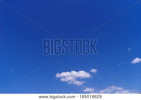 Cumulus clouds in a bright blue sky