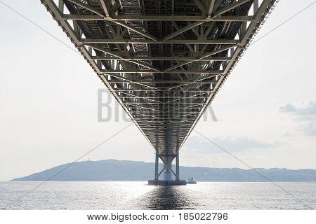 Under Akashi Kaikyo Bridge an the longest suspension bridge in Kobe sea port Japan