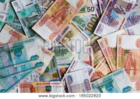 Many monetary denominations of different denominations. Rubles and dollars.