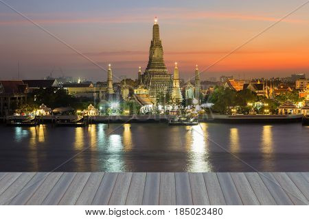 Open wooden floor Arun temple river front with beautiful after sunset sky Bangkok Thailand landmark