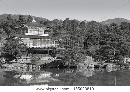 Black and White Kinkaku-ji called Golden Pavilion) is a Zen Buddhist temple in traditional japanes garden Kyoto Japan.